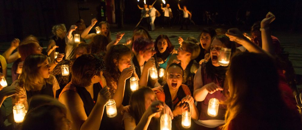 Suppliant Women surrounded by candlelight
